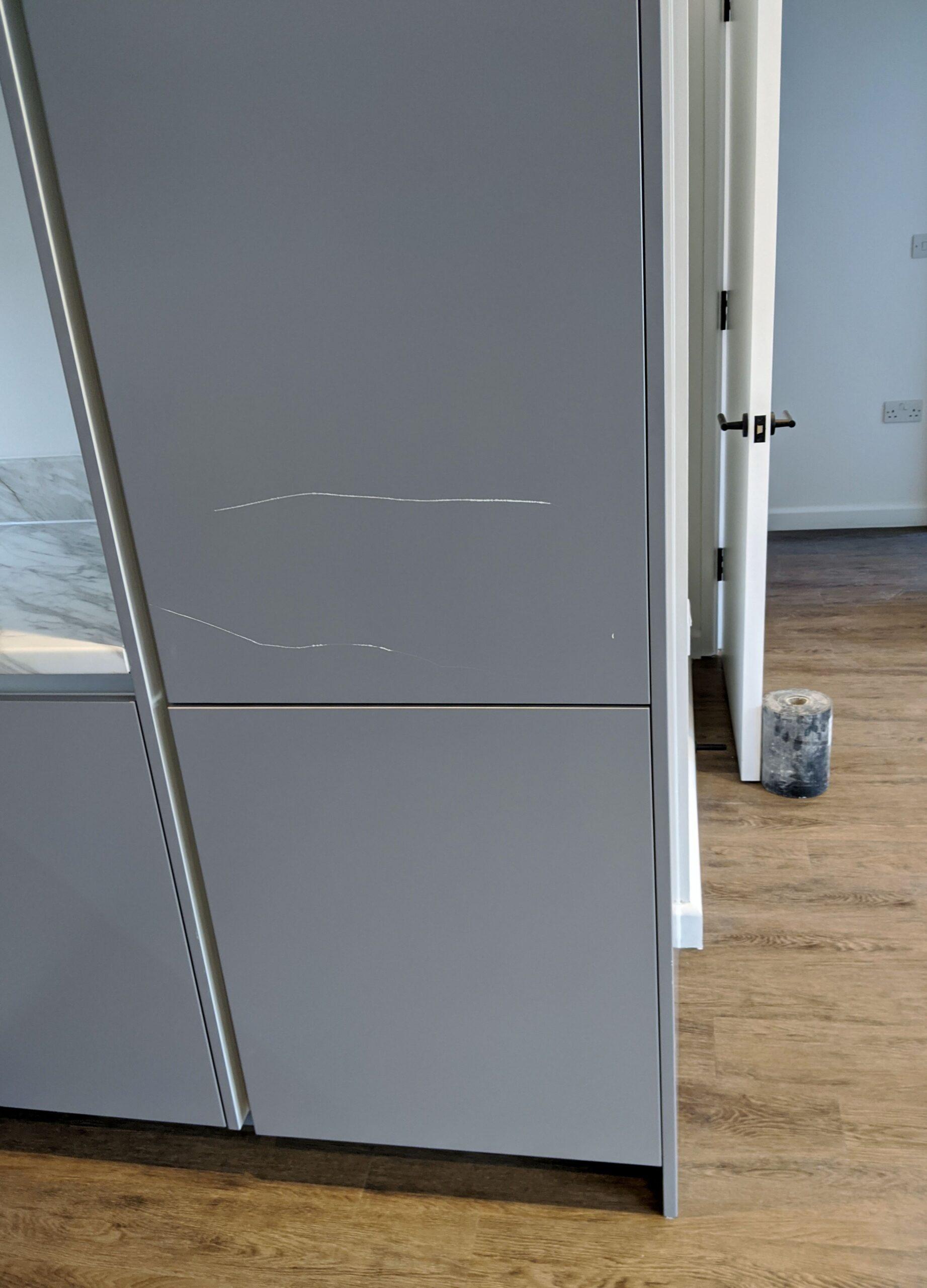 Kitchen cabinet door before repair